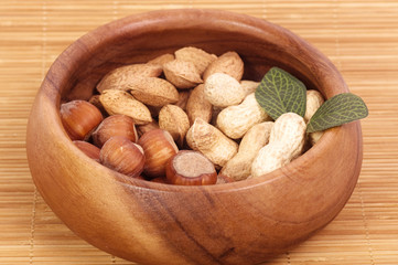 Tasty Hazelnuts on a wooden bowl