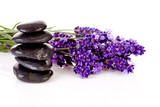 stacked black pebbles stones and lavender flowers