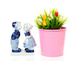 Typical Dutch souvenir in Delft blue and plastic tulips in bucke