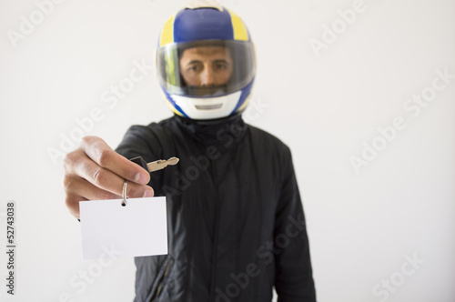 Biker with helmet and offering with copy space