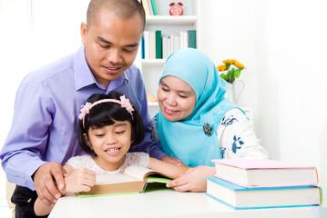 muslim family reading