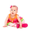 surprised, sad little baby girl in bright multicolored festive d