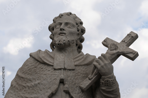 Statue of saint with cross