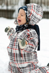 Boy playing in snow
