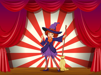 A stage with a witch and her flying broom