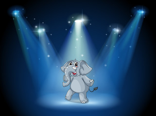 An elephant dancing in the middle of the stage