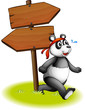 A panda beside the wooden arrowboards
