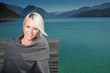 Beauty portrait of woman sitting on a pontoon