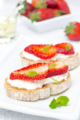 bruschetta with goat cheese, fresh strawberries and mint