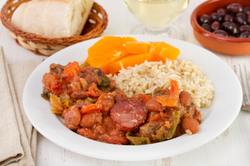 feijoada with rice and orange on the plate