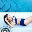 Summer . Beautiful young woman at a pool