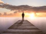 Fototapety man standing on pier