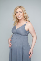 Portrait of adorable pregnant woman in modern dress