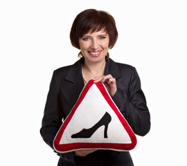 mature woman with road sign