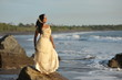 Beautiful bride posing at sea coast