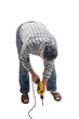 a worker works with electric drill
