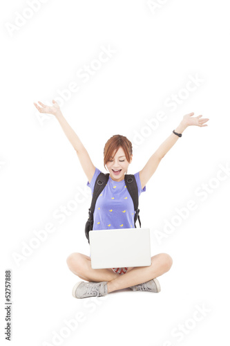 happy young Woman sitting and looking the laptop