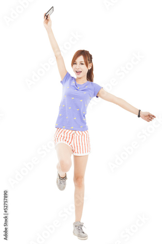 happy  girl jumping with smart phone in the hand