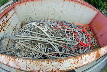 container full of copper electrical cables in a municipal landfi