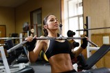 Fototapety Sporty woman in the gym.