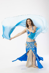 woman with curves dancing an oriental dance belly dancer