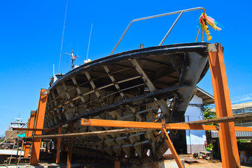 Military boat on repair in dry dock