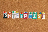 The word Enterprise on a cork notice board