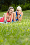 Portrait of two fitness woman having fun in summer environment
