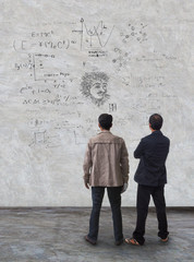 two man standing and watching formula on wall