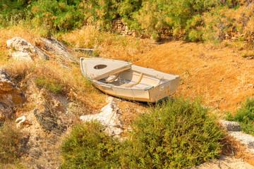 Abandoned fishing boat landmark in greek islands Syros in cyclad