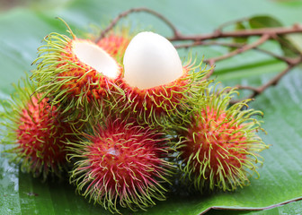 asian fruit rambutan on banana leaves