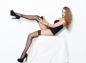 Sensual brunette woman take off stockings