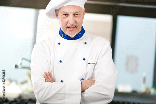Mature chef in his kitchen