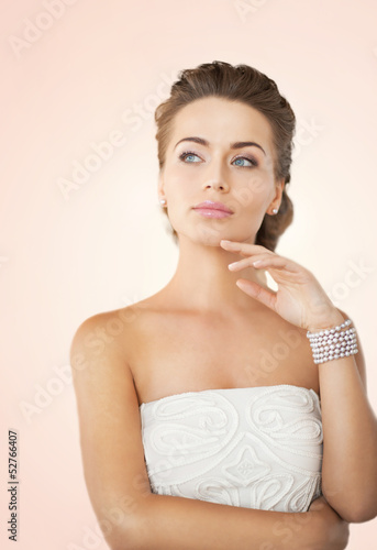 woman with pearl earrings and bracelet