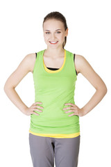 Happy active woman in sports clothes