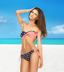 woman in bikini with american flag
