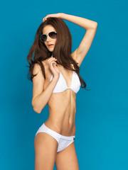 model posing in white bikini