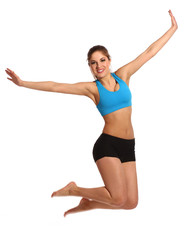 Beautiful woman in a fitness wear jumping