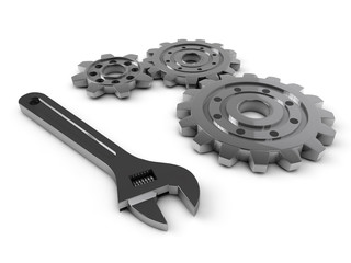 steel gear and wrench tool on a white background