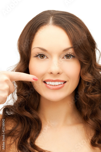 woman pointing at her toothy smile