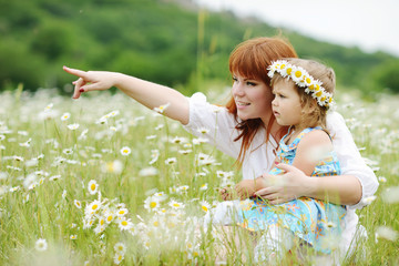 happy family in daisy field