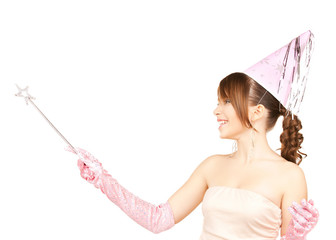 girl in party cap with magic stick
