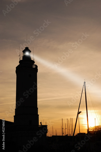 lighthouse at sunset on the port