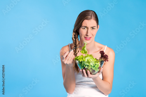 Healthy nutrition - young woman with salad