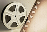 Old motion picture film reel with film strip