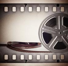 Vieux motion picture bobine de film avec la bande de film. Fond de cru