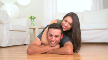 Cute Mexican couple on the floor