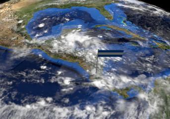 Nicaragua flag on pole on earth globe illustration