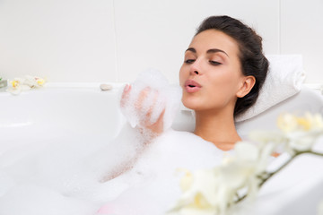 beautiful young woman takes bubble bath