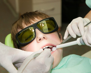 Young boy during drilling tooth